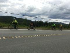 Riders climbing.