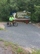 Kevin posing with Sayward Valley welcome sign